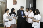 Dr. Vatsal Parikh in his chamber in discussions with staff